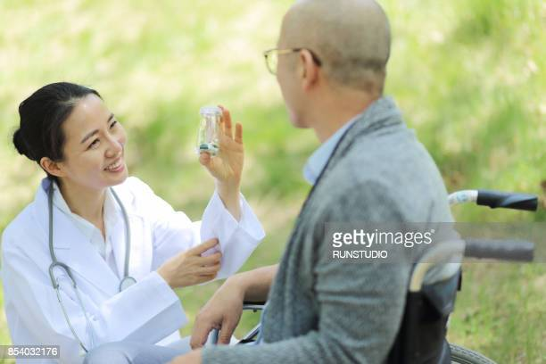 Doctor explaining medication to patient
