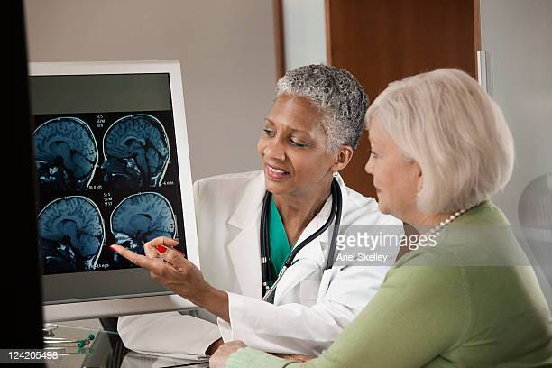 Doctor explaining MRI scan to patient