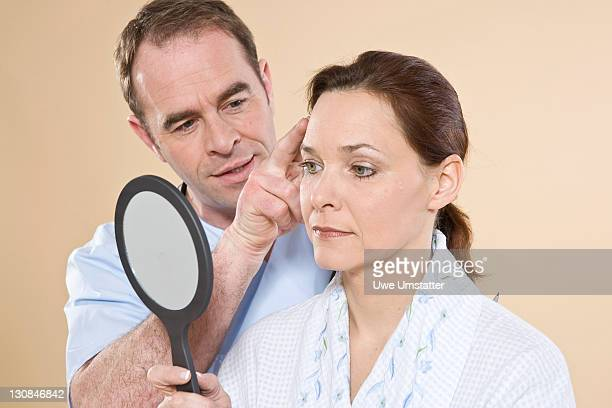 Doctor explaining to a patient the process of a facial operation