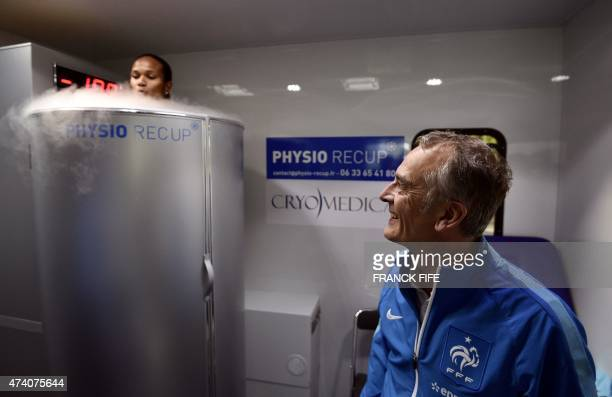 Doctor Fabrice Bryand looks on as France's defender Wendie Renard reacts as she undergoes treatment in a medical device used for cryotherapy at the...