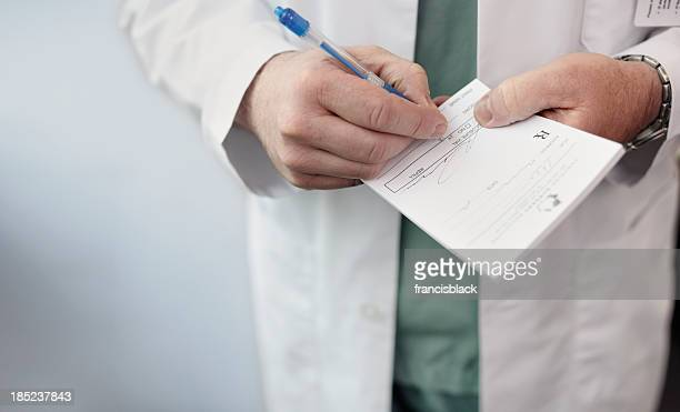 Doctor filling out a prescription