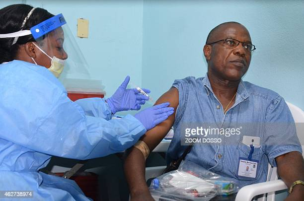 Doctor Francis Kateh from Redemption Hospital volunteers to receive a trial vaccine against Ebola at Redemption Hospital on the outskirts of Monrovia...