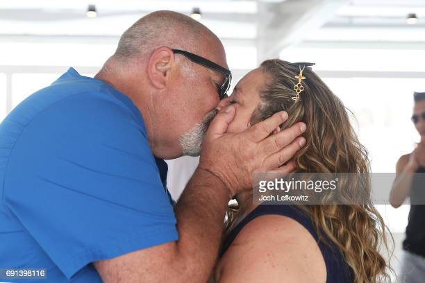 Doctor Frank and wife Lisa D'Ambrosio are seen kissing at the DoctorFrankcom Memorial Day Yacht Cruise on May 29 in Marina del Rey California on May...