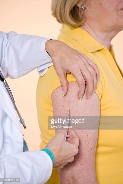 Doctor giving a patient an injection