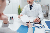 Doctor giving a prescription to his patient, healthcare and hospitals concept