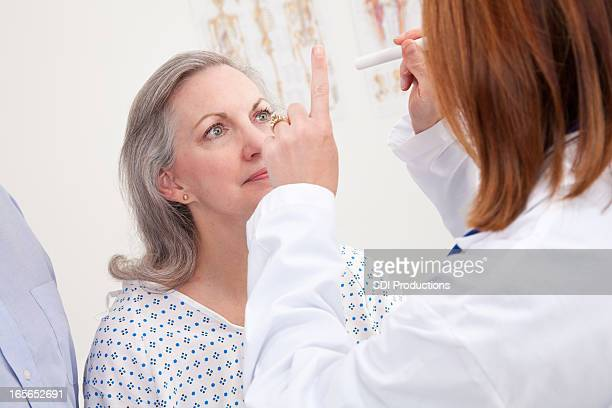 Doctor Giving Exam to Senior Adult Patient