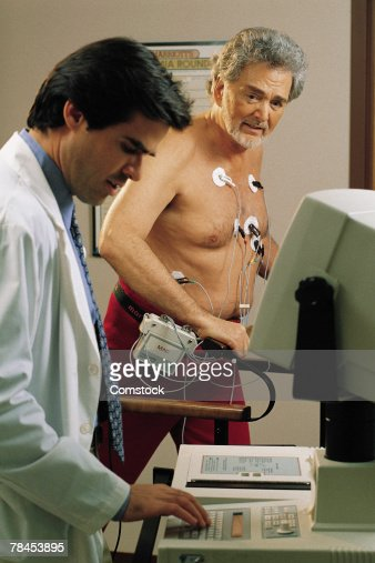 Doctor giving mature man a stress test