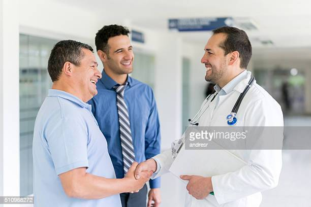 Doctor greeting patient with a handshake