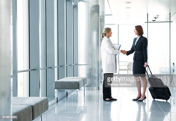 Doctor greeting pharmaceutical rep in lobby