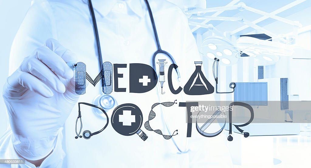 doctor hand drawing design word MEDICAL DOCTOR as concept : Stock Photo