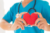 Doctor hands holding red heart. Healthcare And Medical concept.