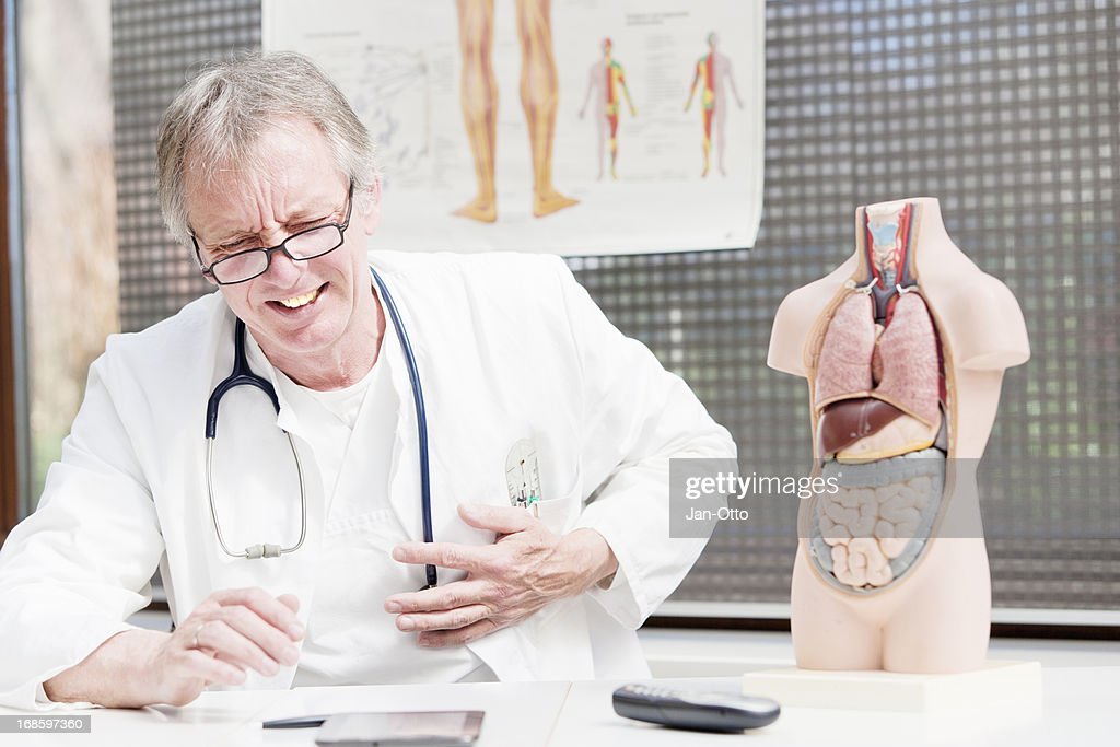 Doctor having heart attack : Stock Photo