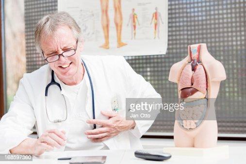 Doctor having heart attack : Stock Photo