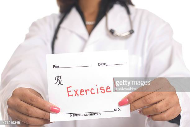 A doctor holding a prescription saying exercise