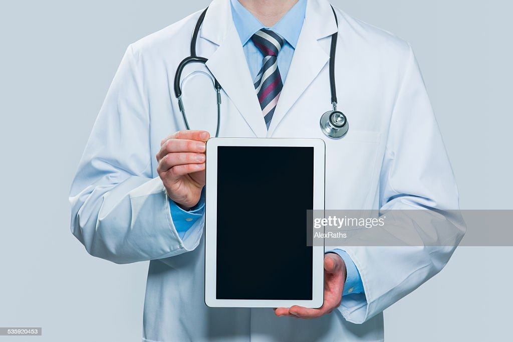 Doctor holding blank digital tablet : Stock Photo