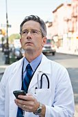 Doctor holding cell phone