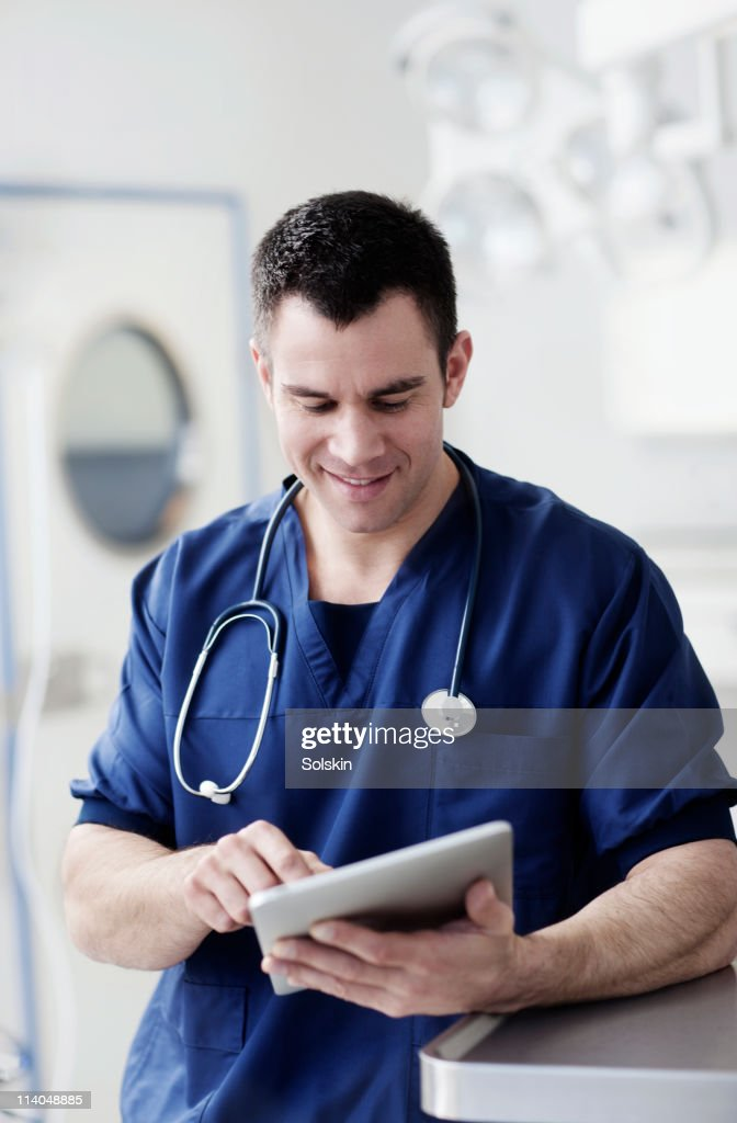 doctor holding digital tablet : Stock Photo
