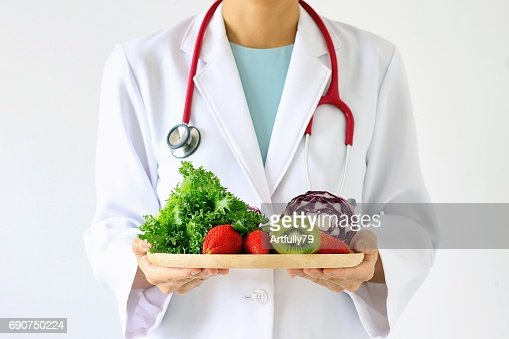 Doctor holding fresh fruit and vegetable, Healthy diet, Nutrition food as a prescription for good health. : Stock Photo