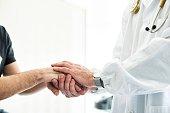 Doctor Holding Patient's Hands