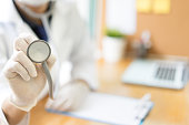 Doctor holding stethoscope in hospital concept - clinic heath care equipment tool in lab with copy space