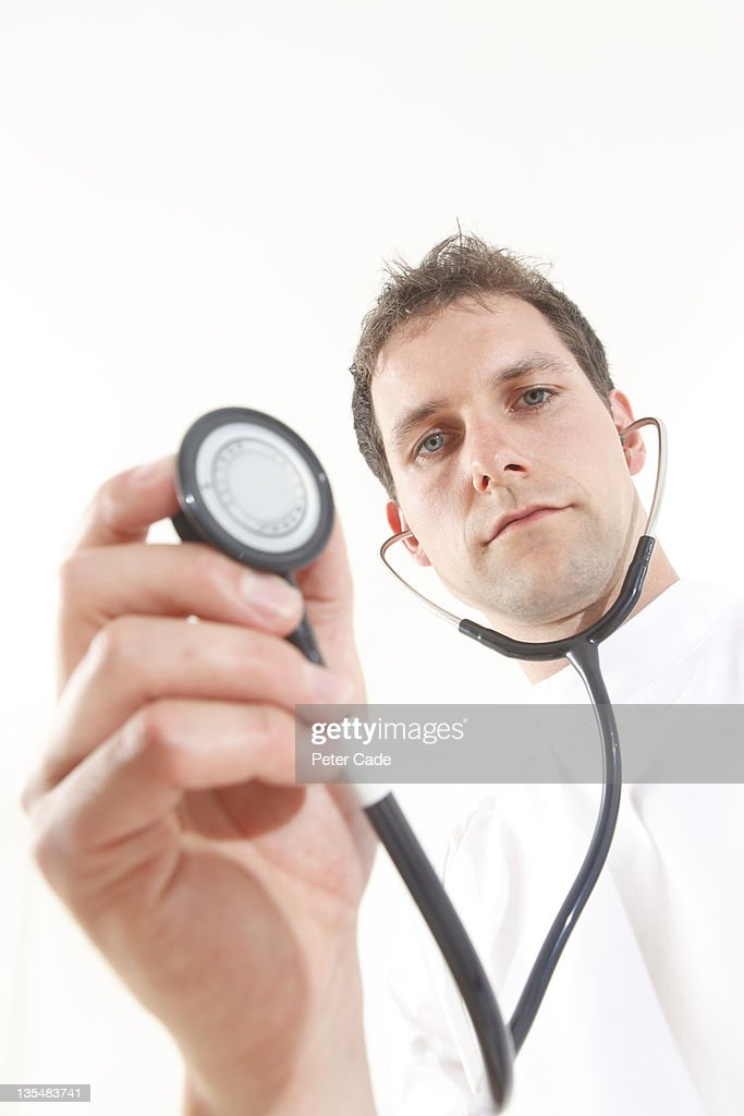 Doctor holding stethoscope : Stock Photo