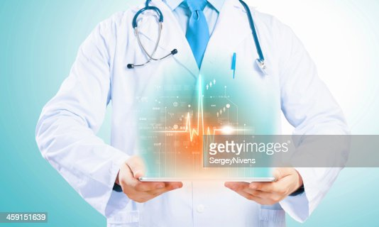 Doctor holding tablet pc : Stock Photo