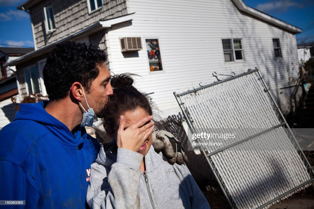 Doctor Howard Goldsmith consoles his wife, Doctor Rosanna Troia while helping clean out Troia's mother's home in the Midland Beach neighborhood of Staten Island on November 3, 2012 in New York City. As clean up efforts from Superstorm Sandy continue, colder weather and another storm predicted for next week are beginning to make some worried.