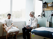 Doctor in discussion with patient in exam room