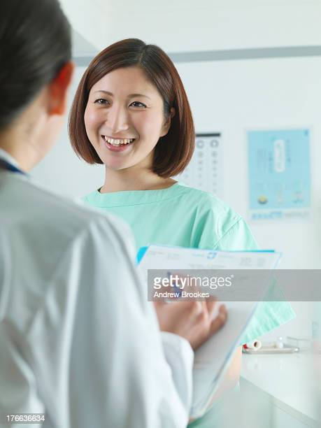 Doctor in discussion with patient in examination room