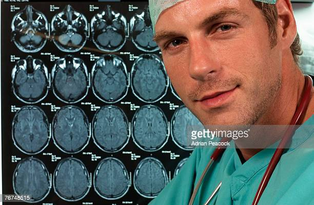 Doctor in surgical scrubs with brain scans