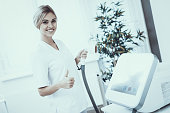 Doctor in White Uniform with Medical Equipment. Modern Cosmetology. Proffesional Cosmetologist. Doctor with Laser Epilator. Women's Beauty Concept. Medical Equipment. Girl in White Coat.