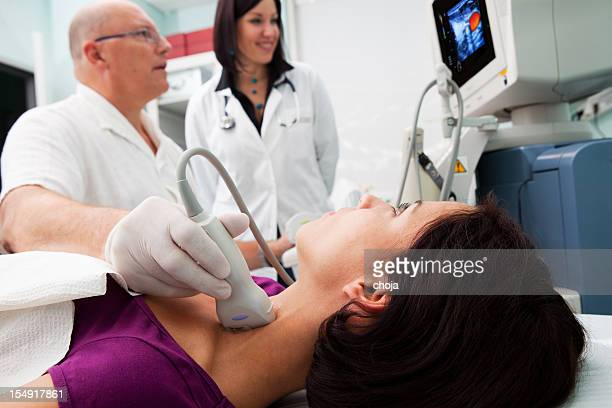 Doctor is giving beautiful young patient an ultra sound