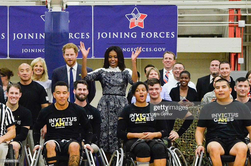 Doctor Jill Biden, Prince Harry and First Lady Michelle Obama pose for a photo with players during the Joining Forces Invictus Games 2016 Event at the Wells Fields House on October 28, 2015 in Fort Belvoir, Va.