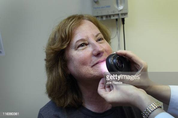 Doctor Jonette Keri Dermatologist University of Miami School of Medicine uses a dermatoscope as she examines Marcia Spevak Breiter for symptoms of...