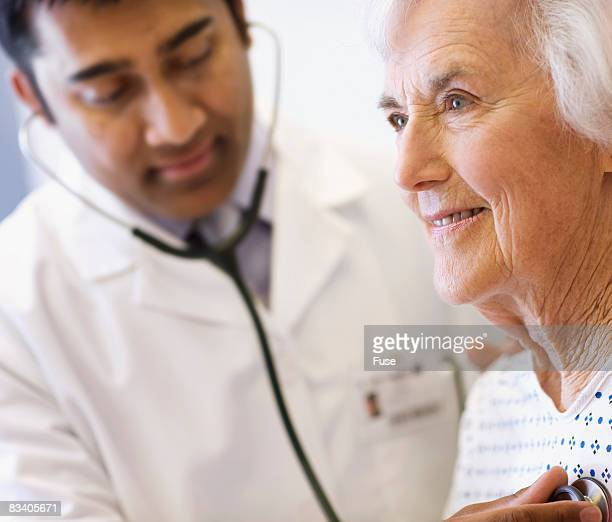 Doctor Listening to Patient's Chest