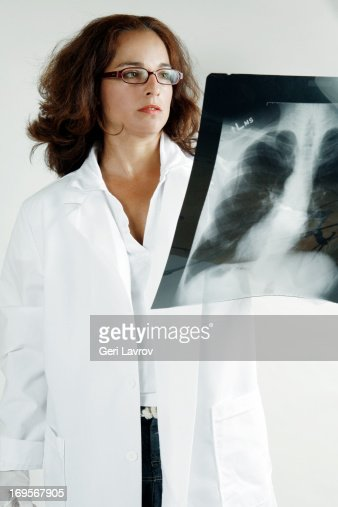 Doctor looking at an X-ray scan : Stock Photo