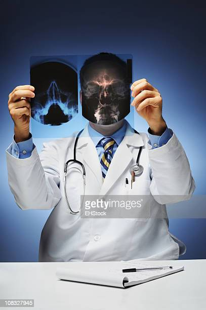 Doctor Looking at Head Xray