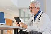 Doctor looking at his tablet