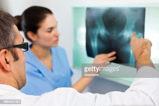 Doctor looking at X-ray image of a pelvis