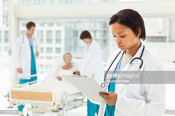 Doctor Looking Over a Medical Chart