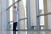 Doctor lost in thoughts at hospital window