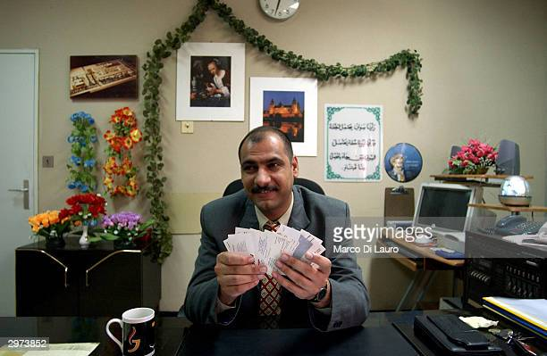 Doctor Mubeen Ali Mussa Director of the Samawa Maternity and Children's Hospital 170 miles south of Baghdad shows dozens of buisness cards from...