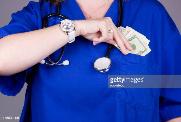 Doctor or Nurse Placing Money in Her Pocket