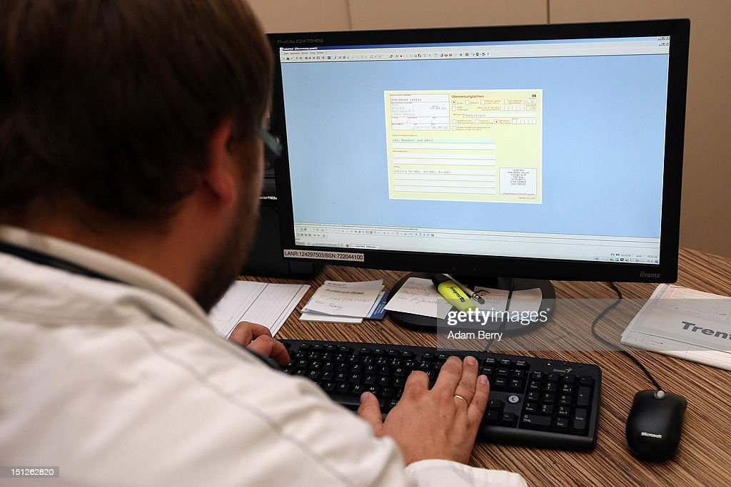 . A doctor prepares a prescription on a computer screen for a patient on September 5, 2012 in Berlin, Germany. Doctors in the country are demanding higher payments from health insurance companies (Krankenkassen). Over 20 doctors' associations are expected to hold a vote this week over possible strikes and temporary closings of their practices if assurances that a requested additional annual increase of 3.5 billion euros (4,390,475,550 USD) in payments are not provided. The Kassenaerztlichen Bundesvereinigung (KBV), the National Association of Statutory Health Insurance Physicians, unexpectedly broke off talks with the health insurance companies on Monday.