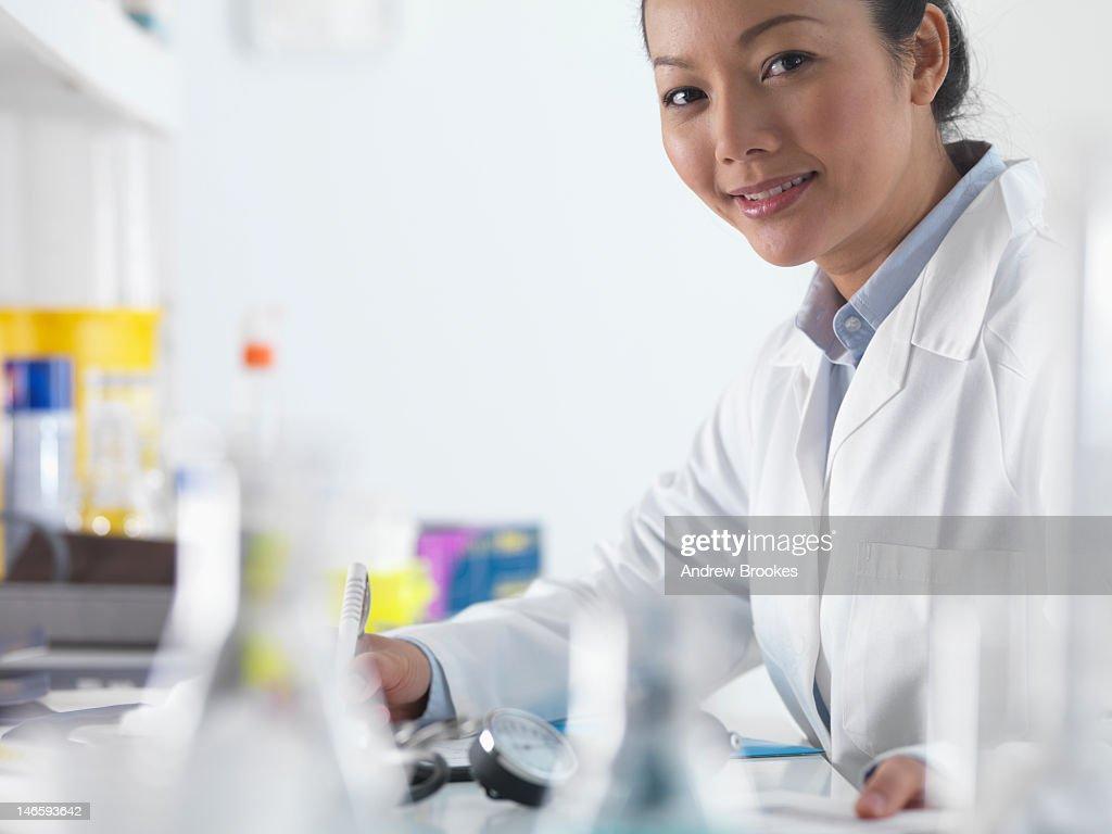 Doctor preparing notes in hospital : Stock Photo