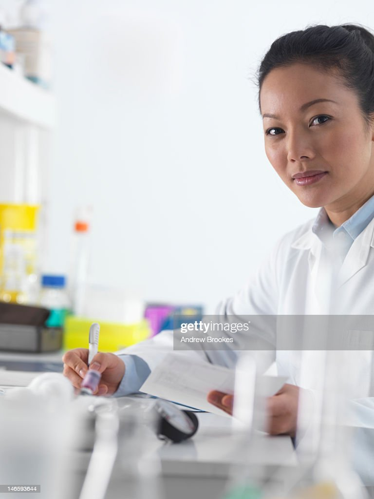 Doctor preparing notes in hospital : Stock Photo