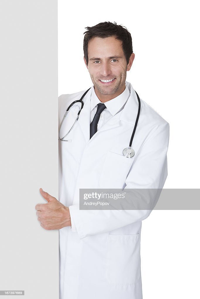 Doctor presenting empty banner : Stock Photo