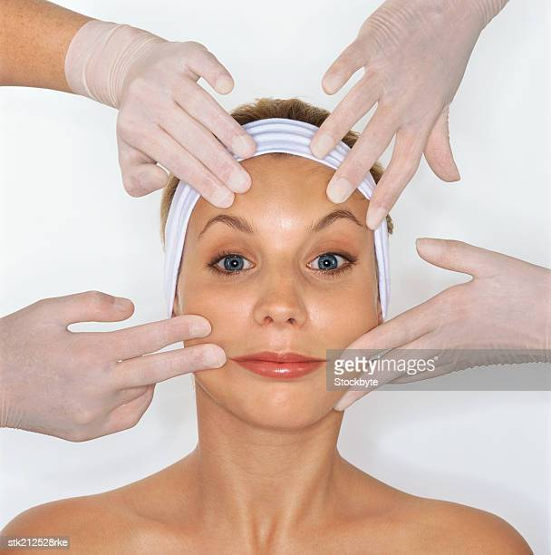 doctor pulling back the skin on a woman's face