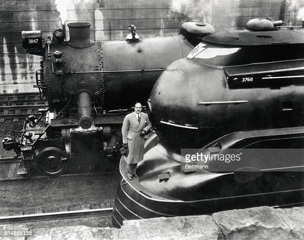 Doctor Raymond Loewy with his latest designed locomotive