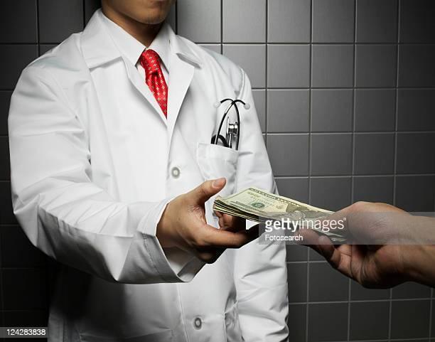 Doctor Receiving US Dollars